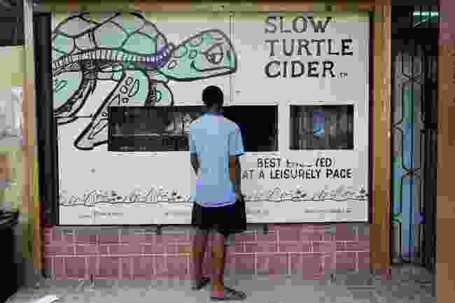 Stocking up on cider on Praslin (Peter Moore)