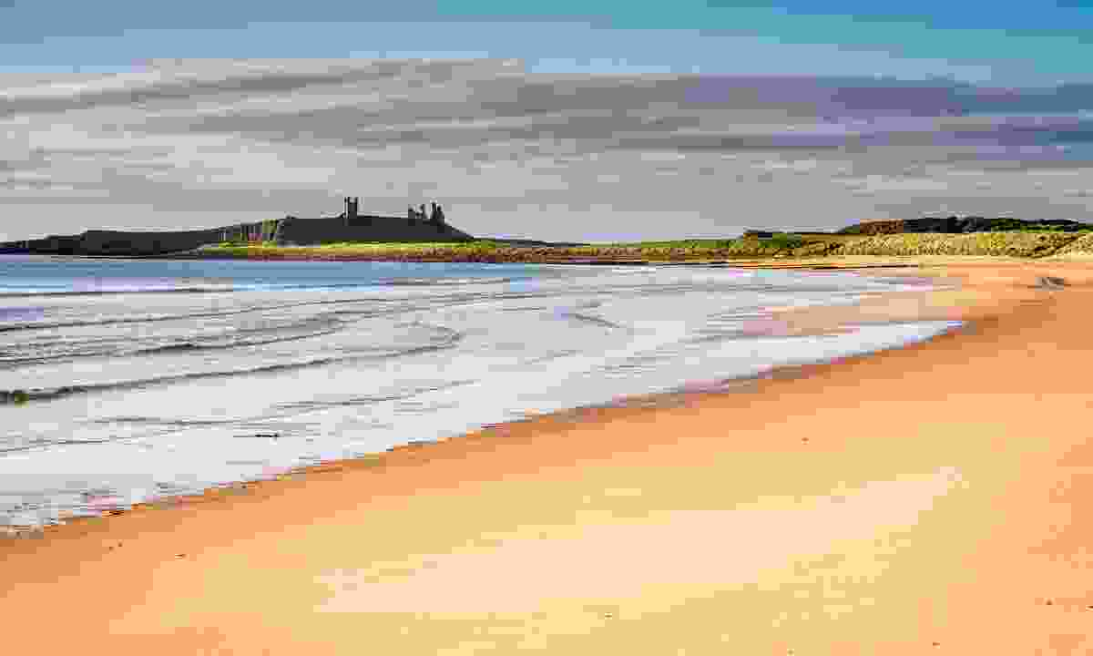Embleton Sands leading to the ruins of Dunstanburgh Castle (Shutterstock)