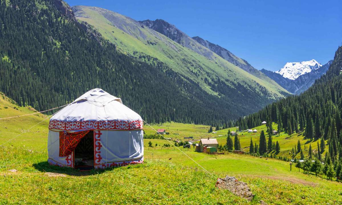 White yurt in the mountains of Kyrgyzstan (Dreamstime)