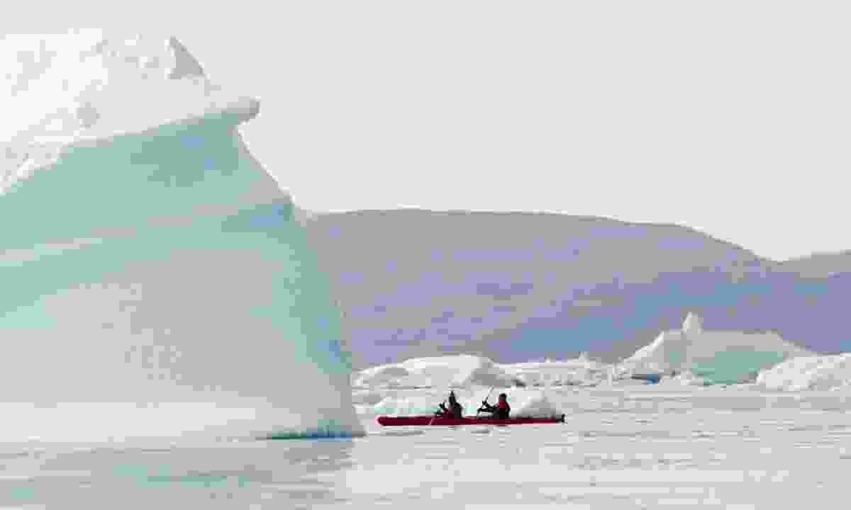 Kayaking between icebergs in Greenland (Dreamstime)