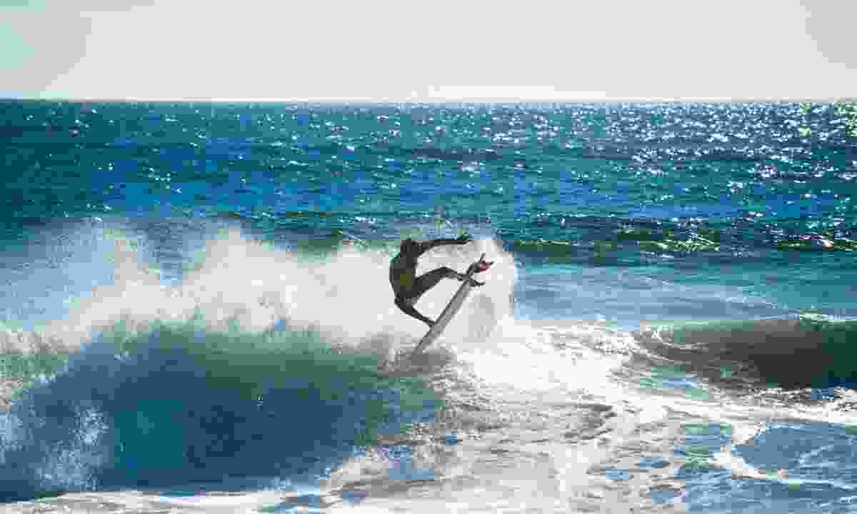 Surfing the wild waves at Pichilemu, Chile (Dreamstime)