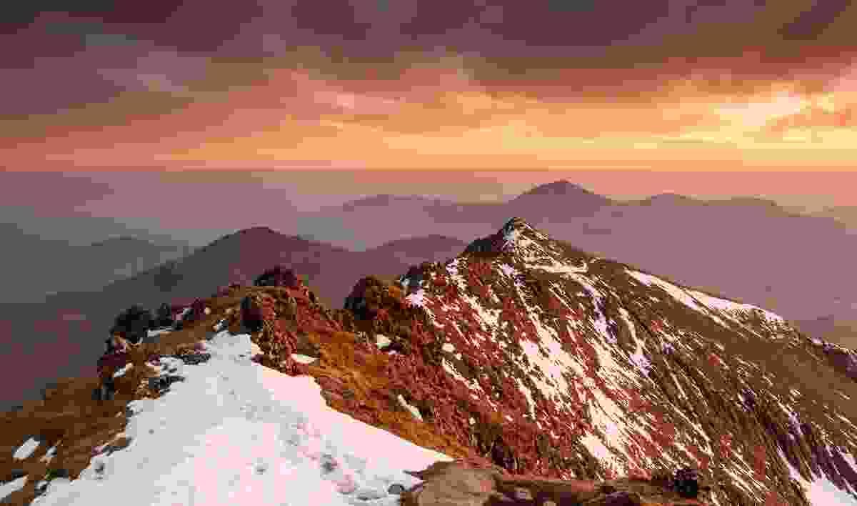 Bwlch Main, Yr Aran and Moel Hebog from below the summit of Yr Wyddfa – March evening (Nick Livesey)