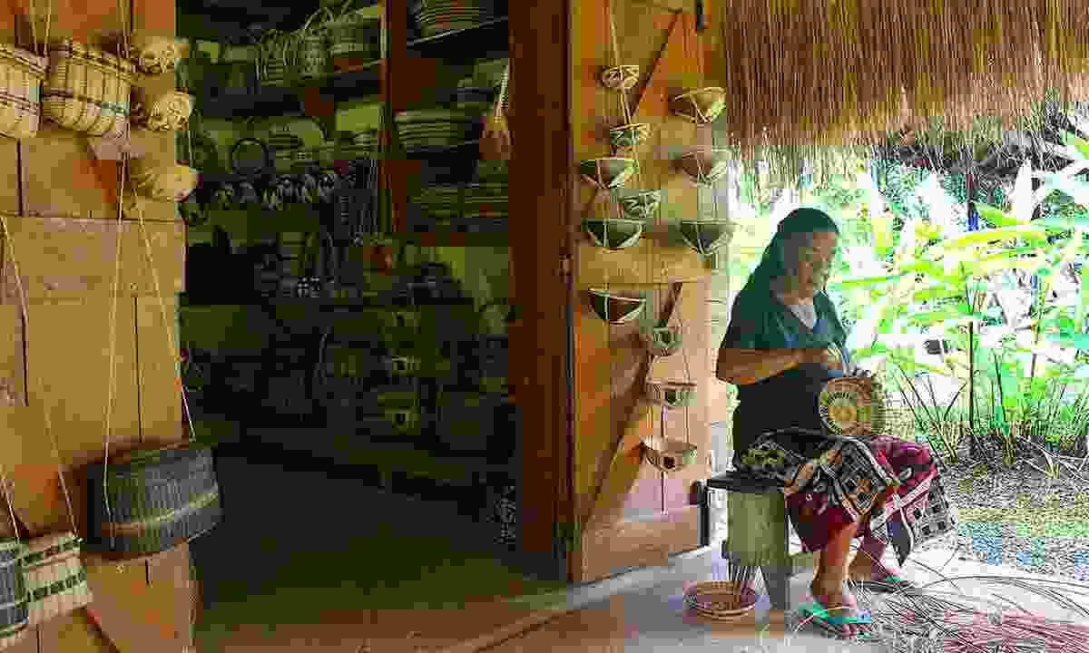 A woman making a traditional reed basket