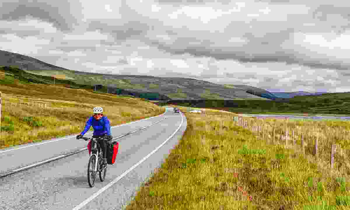 Flying through the Scottish Highlands on a bike (Shutterstock)