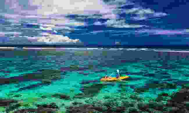 Paddling over a tropical coral reef (Shutterstock)