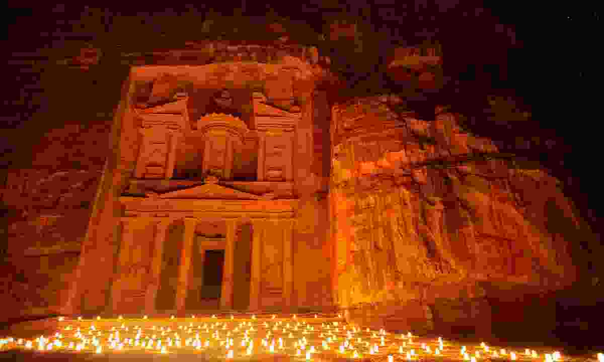 The Treasury at Petra lit up by candles at night (Shutterstock)