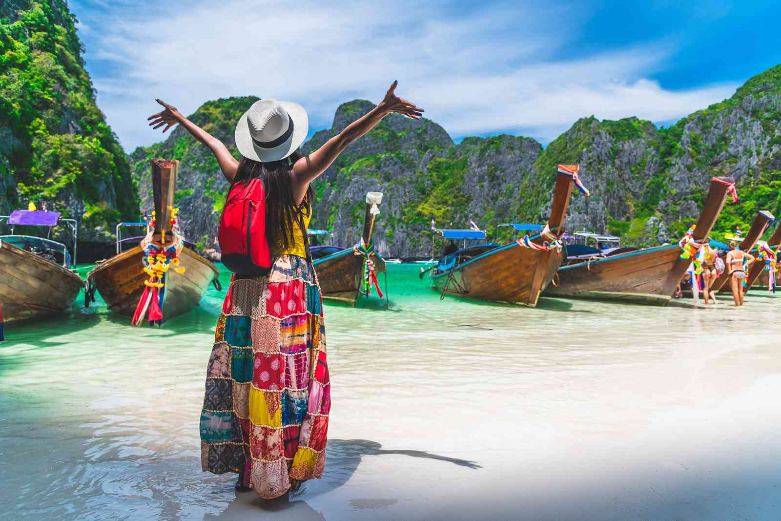 A woman travelling by boat in Thailand (Shutterstock)