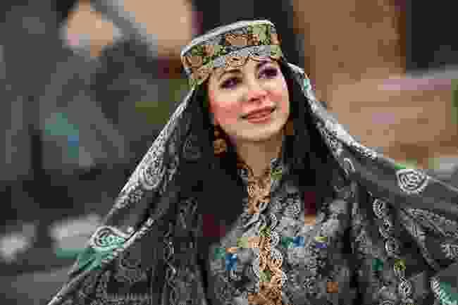 An Azerbaijani woman wearing national dress during Nowruz (Shutterstock)