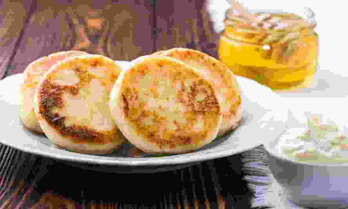 Syrniki, served with honey and sour cream (Dreamstime)