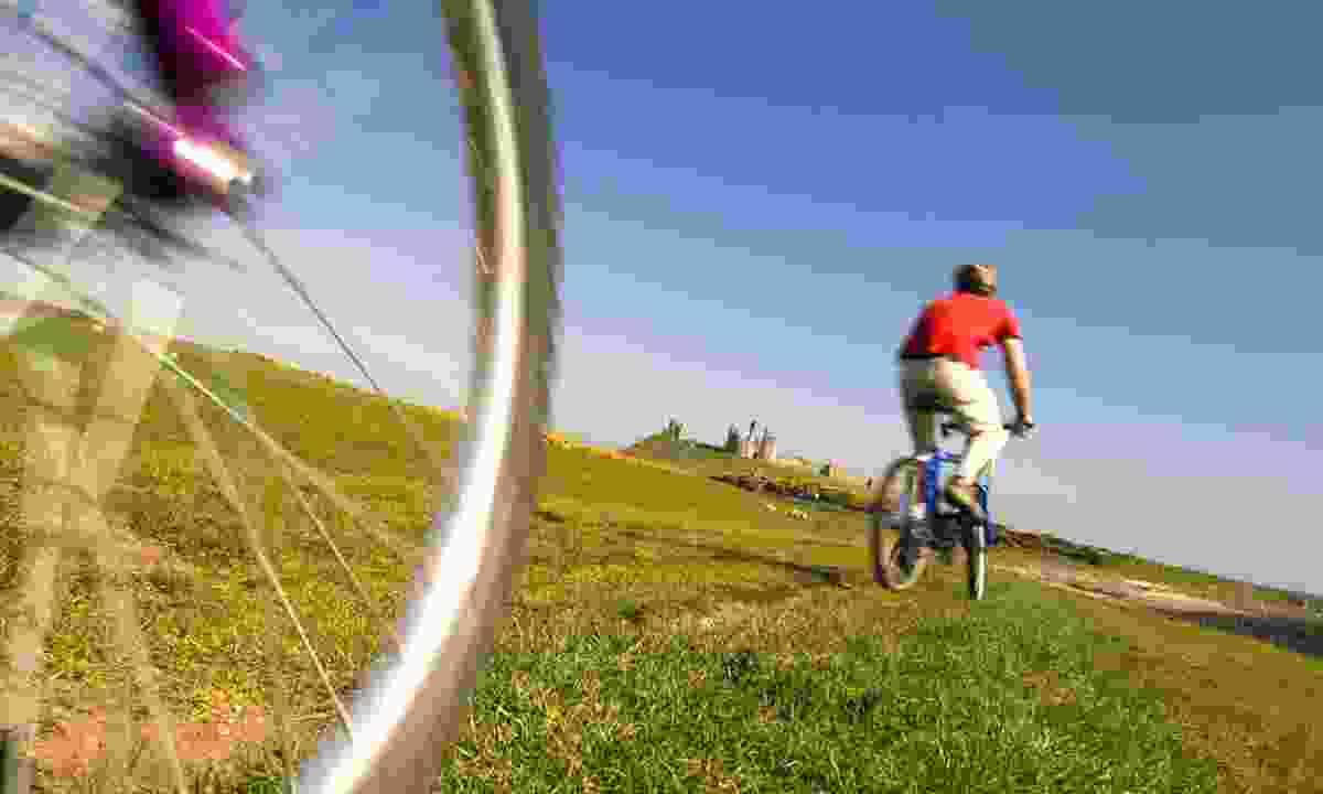 Cycling near Banburgh Castle (VisitNorthumberland)