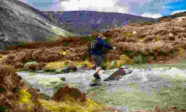 Crossing a brook enroute to Mount Keen (Shutterstock)
