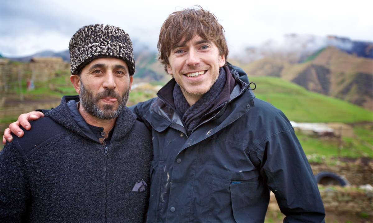 Simon in Dagestan with a tightrope walker (Jonathan Young BBC)