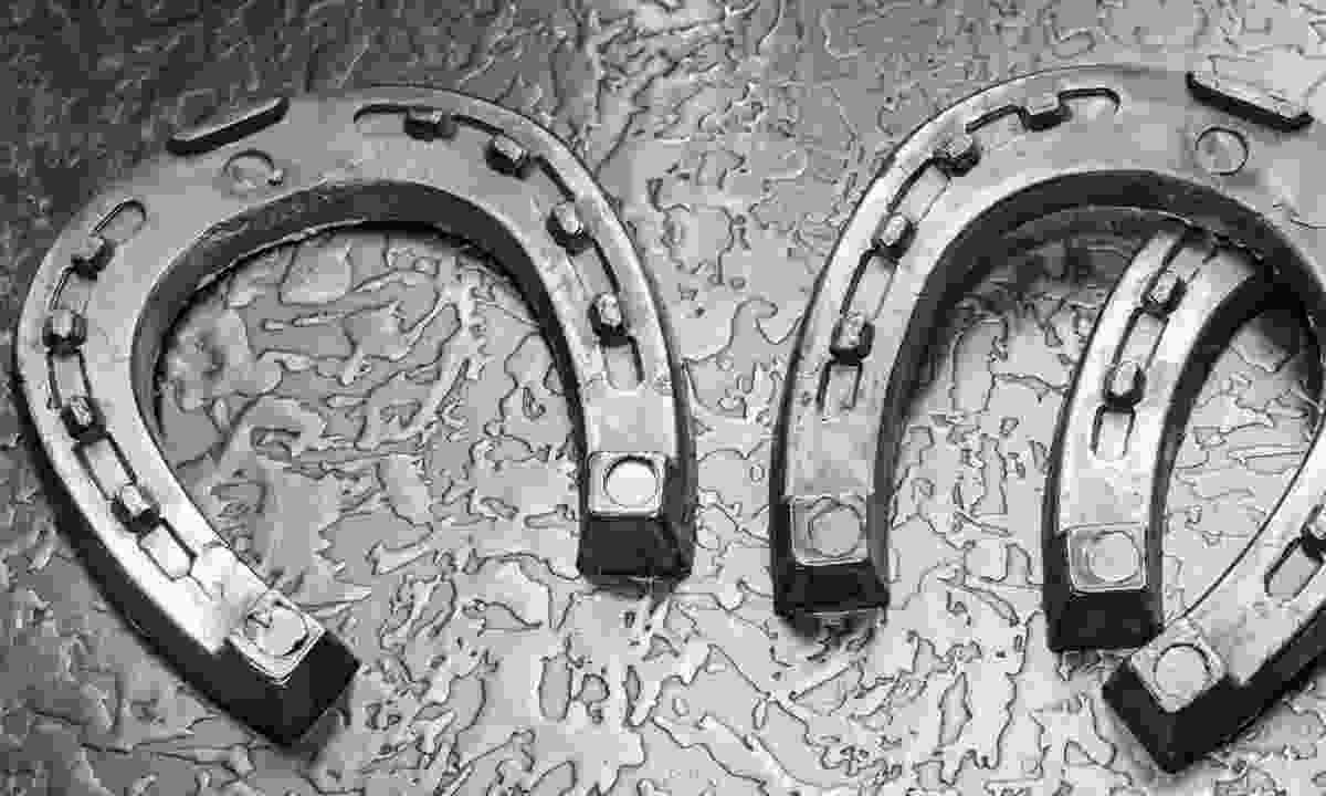 Casts (horseshoes) ready to be melted (Dreamstime)