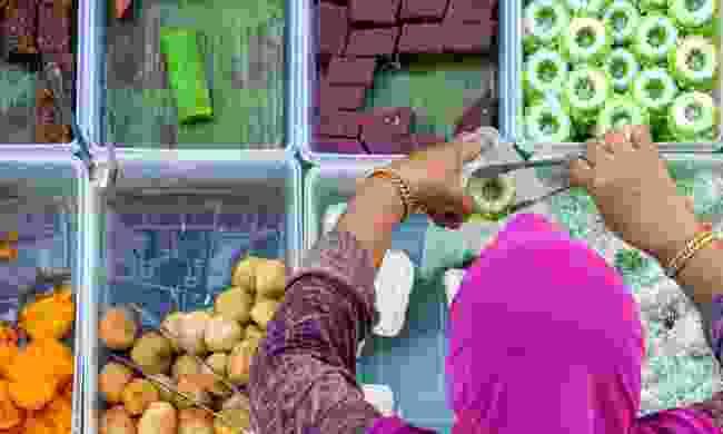A Food stall in Kota Kinabalu city food market (Shutterstock)