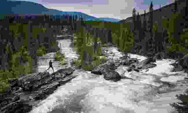 Hiker on rocks at Ghost Falls (Destination BC/Blake Jorgenson)