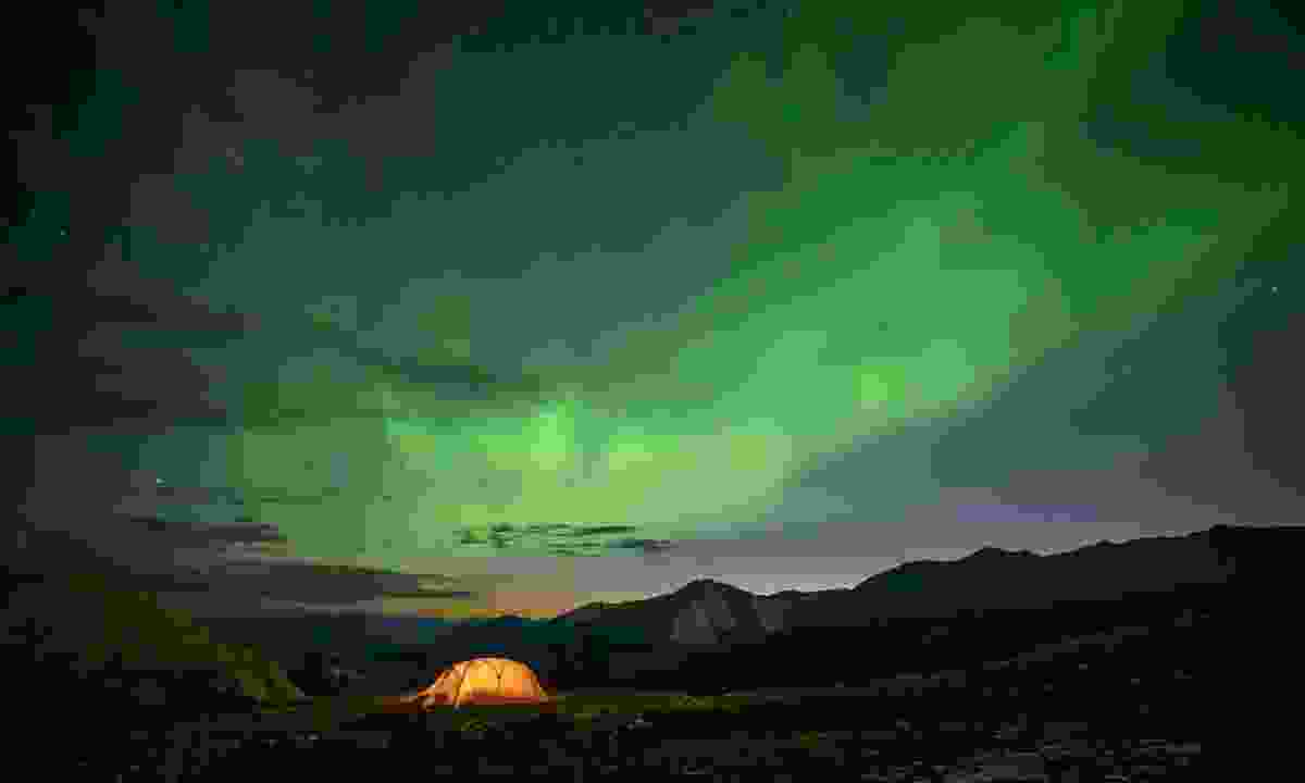 A tent under the Northern Lights on Summit Peak Trail (Destination BC/Andrew Strain)