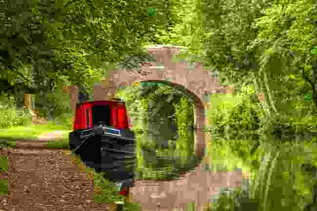 A narrowboat on a tranquil canal (Shutterstock)