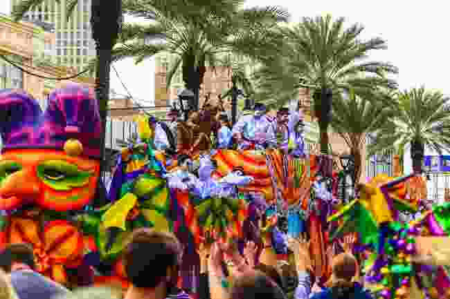 Mardi Gras parade through the streets of New Orleans (Shutterstock)
