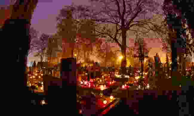 Graveyard lit with candles (Dreamstime)