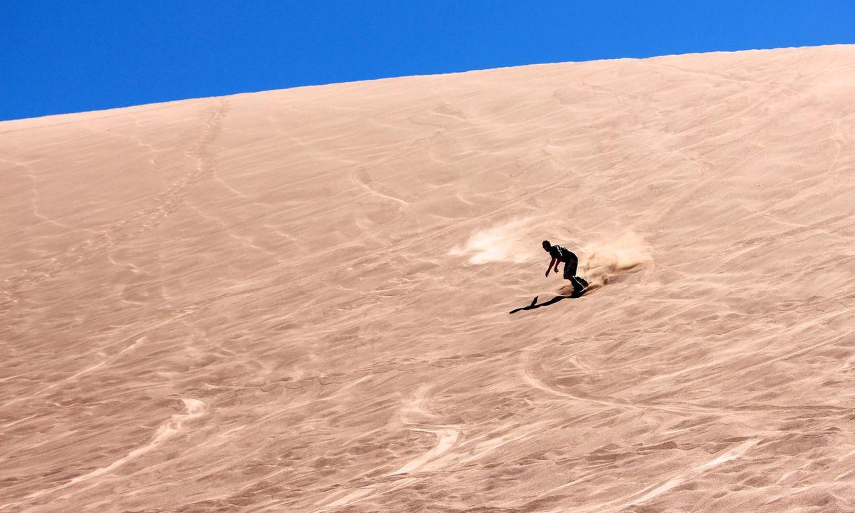 Sandboarding in the Atacama Desert (Dreamstime)