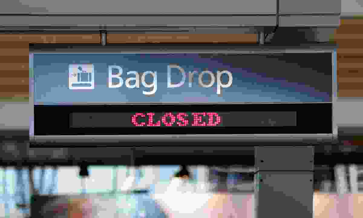 Bag drop closed (Dreamstime)