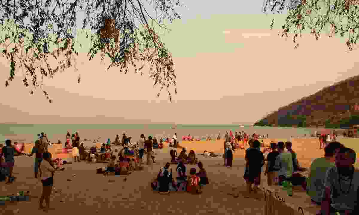 People on the beach at sunset at Lake of Stars Festival (David Harrison)
