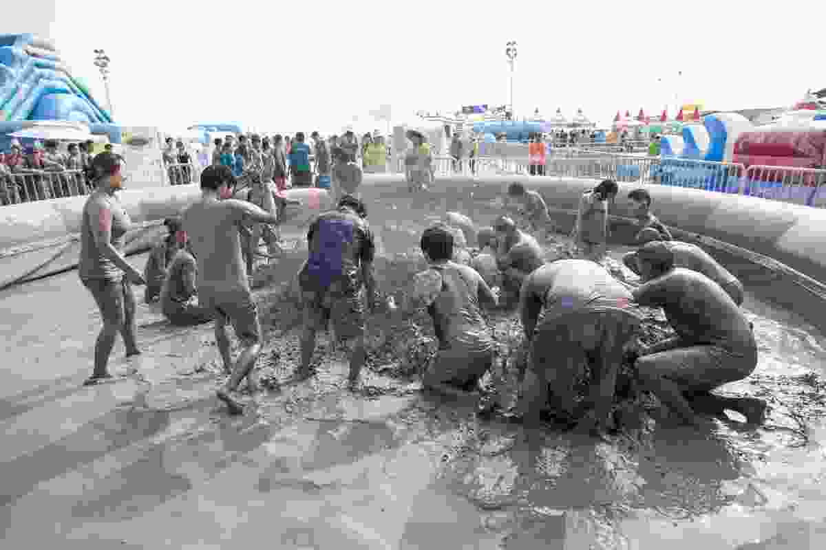 Boryeong Mud Festival in action of Daecheon Beach, Boryeong, South Korea (Shutterstock)