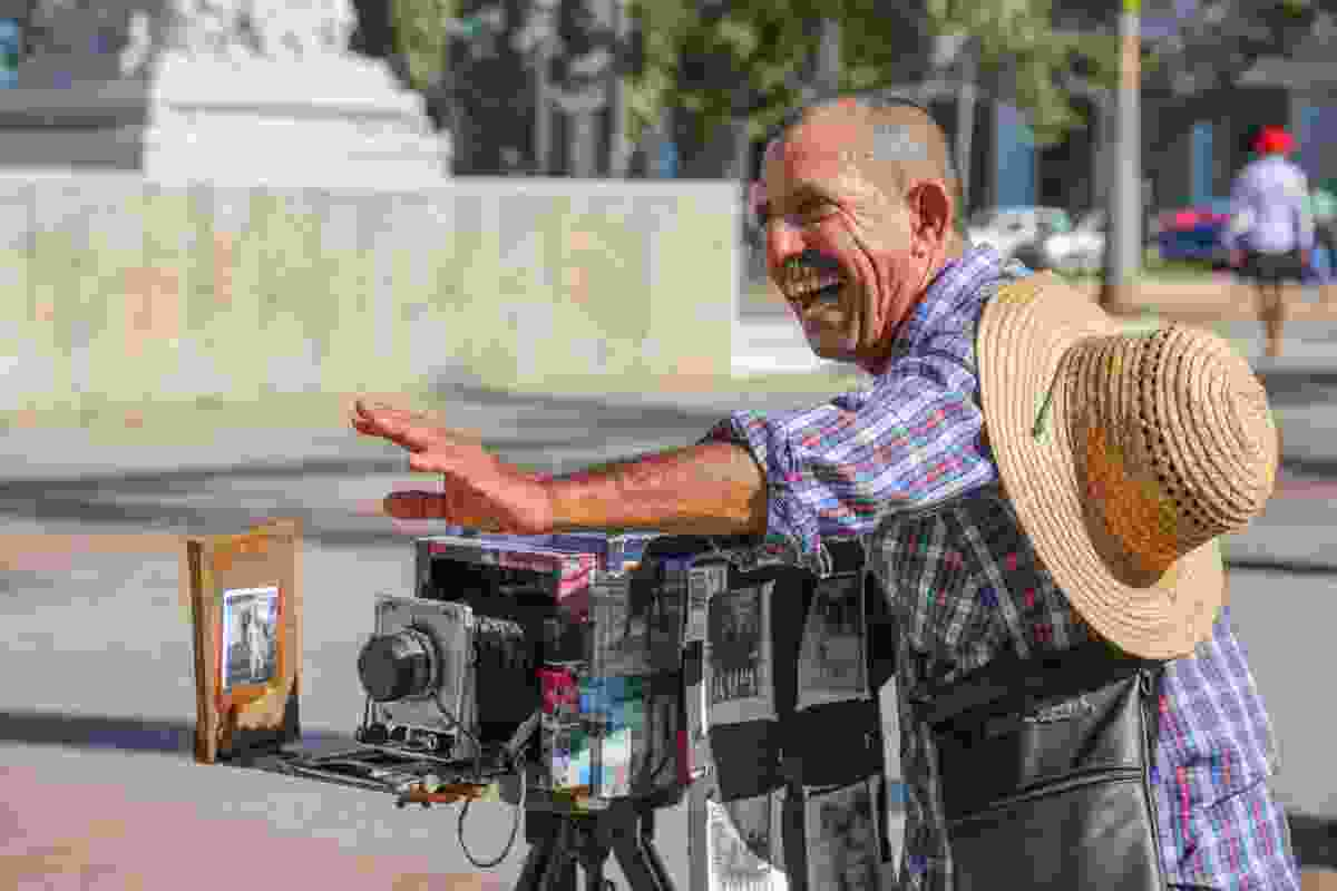 A photographer specialising in taking old-style black and white portraits of tourists on Parque Central (Graeme Green)