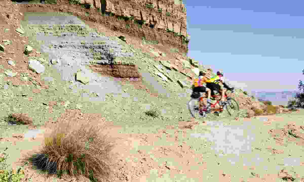 Cycling Rim Rock Drive in Colorado National Park (Dreamstime)