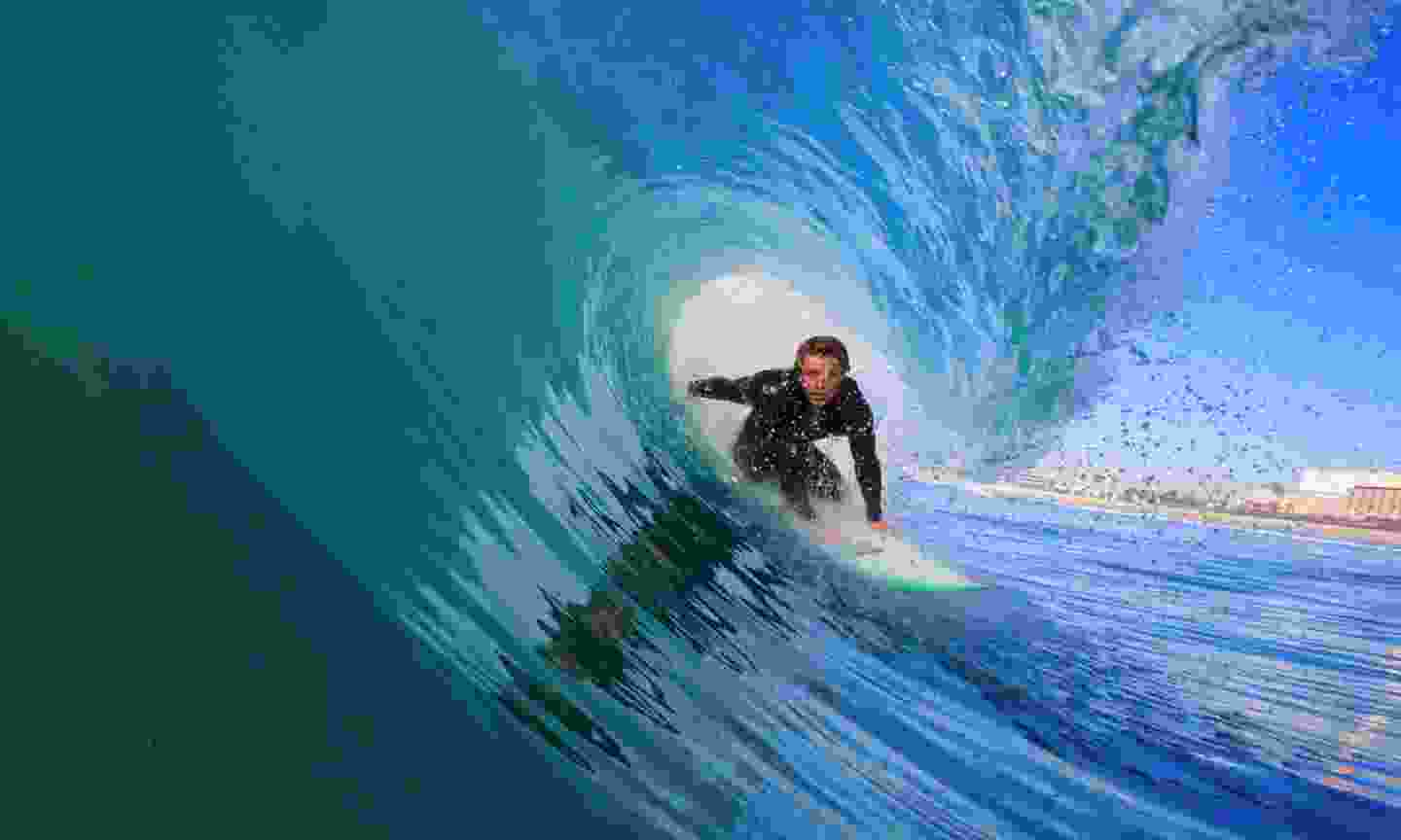 Surfer riding a blue wave on the North Shore of Oahu (Dreamstime)