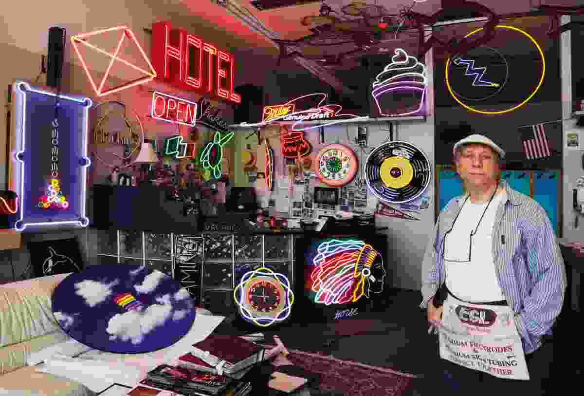 Robert stands among his neon sign collection (Rick Sammon)