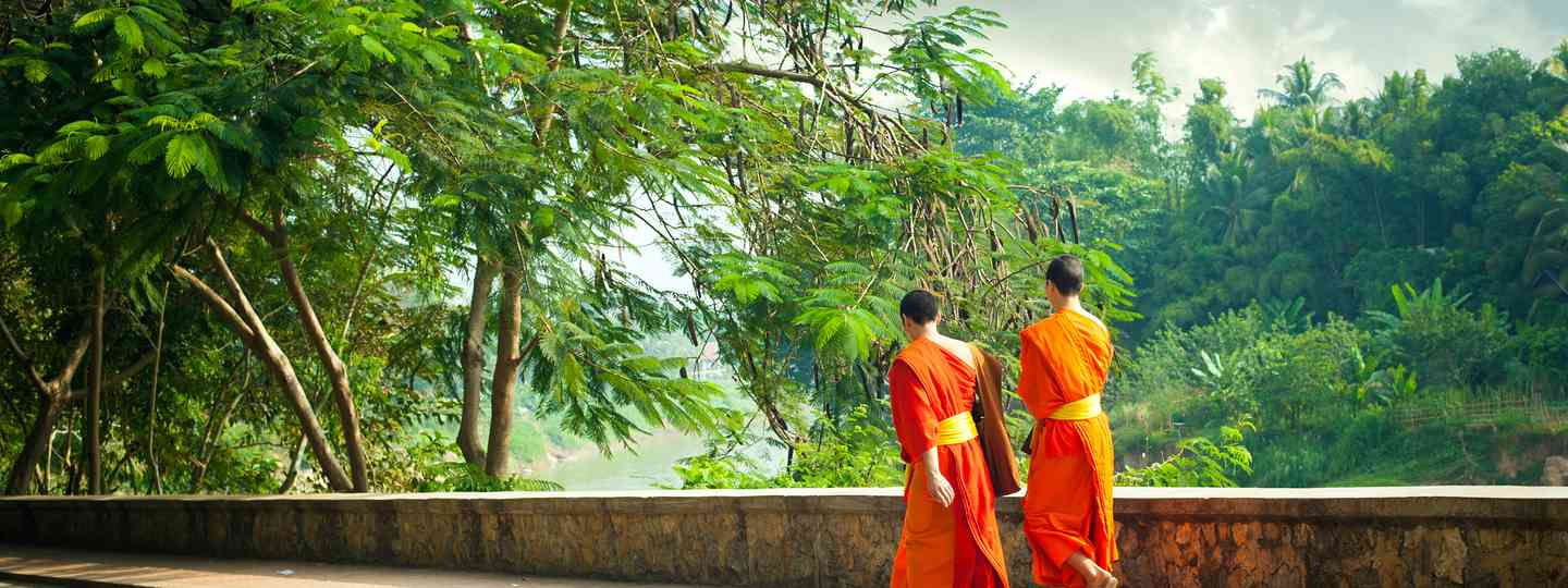 Monks by the river in Luang Prabang (Shutterstock)