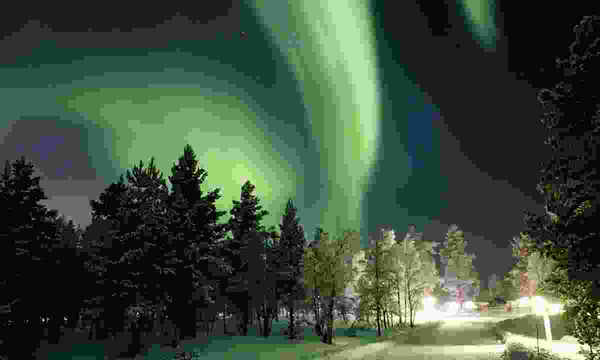 The northern lights brightening the sky above Kakslauttanen Arctic Resort (Shutterstock)