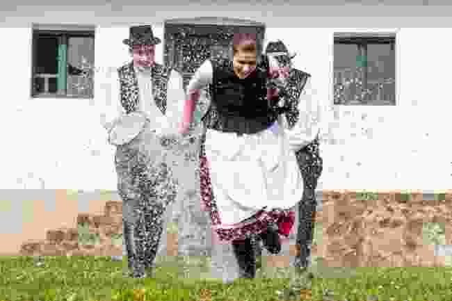A woman getting soaked in Hungary (Shutterstock)