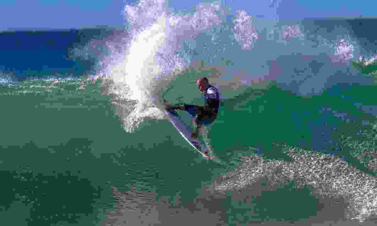 Kelly Slater at Jeffreys Bay South Africa. Something to aspire to (Dreamstime)