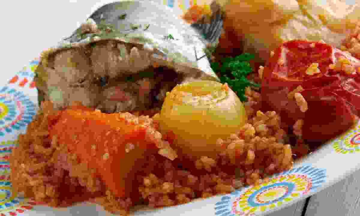 Thieboudienne - a traditional dish from Senegal (Dreamstime)