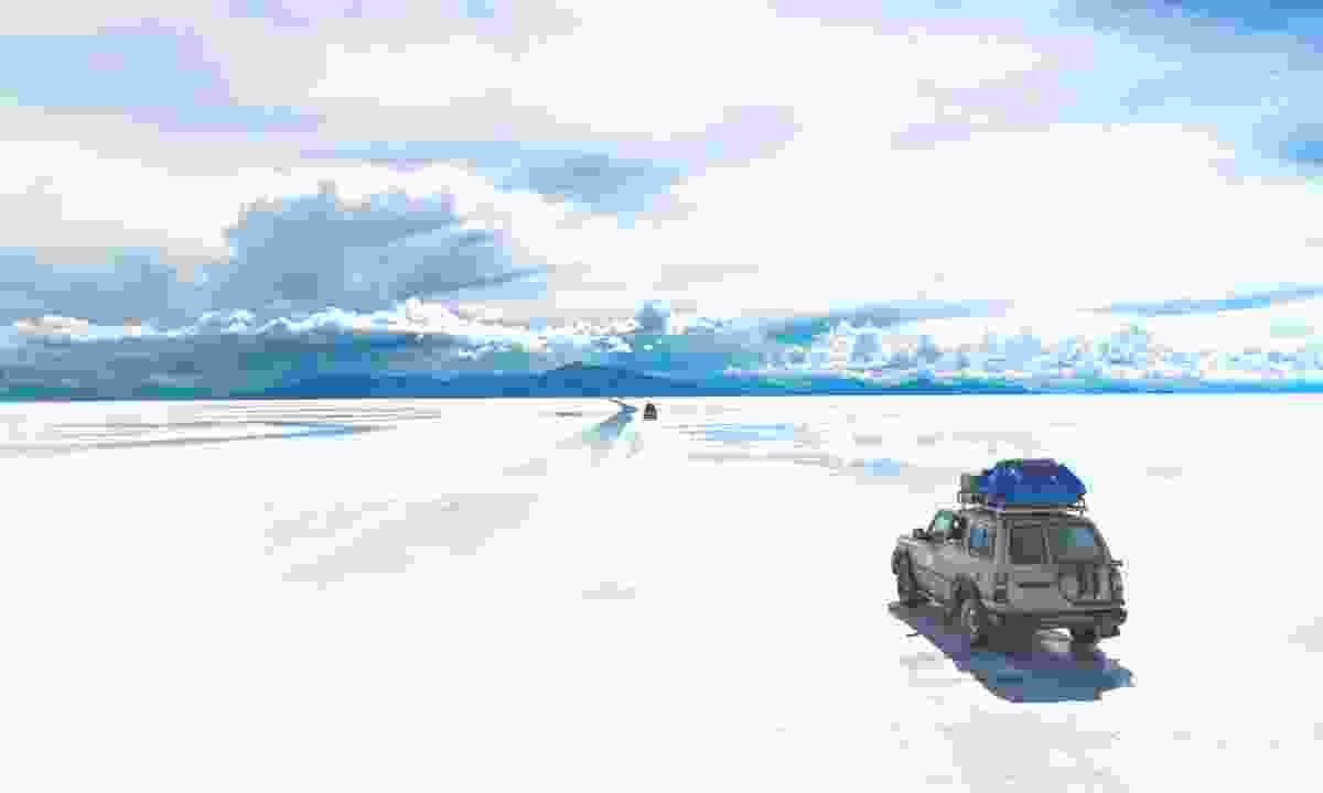 4WDs crossing the Salar de Uyuni salt flat in Bolivia (Shutterstock)