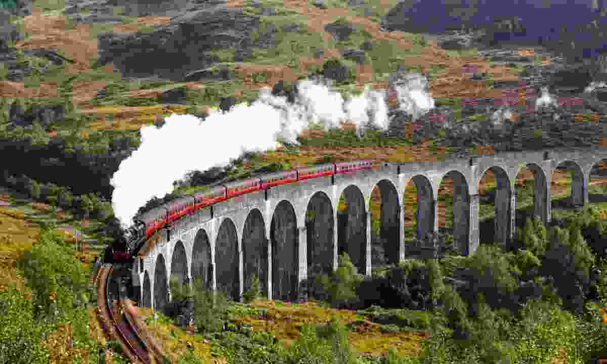 Jacobite steam train crossing Glenfinnan Railway Viaduct (Shutterstock)