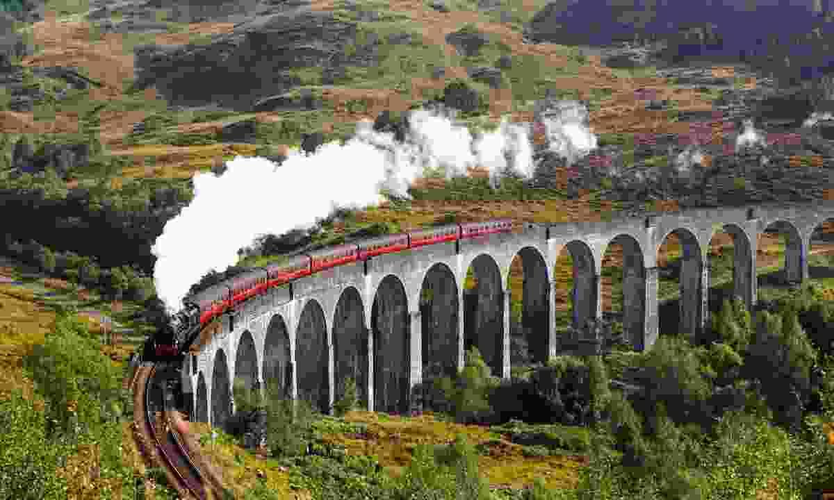 Jacobite steam train crossing Glenfinnan Railway Viaduct (Shutterstock)