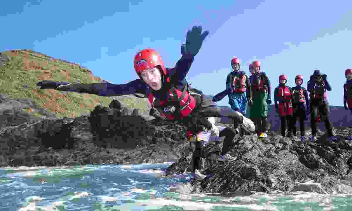 Kids coasteering on the Pembrokeshire coast (Celtic Quest Coasteering)