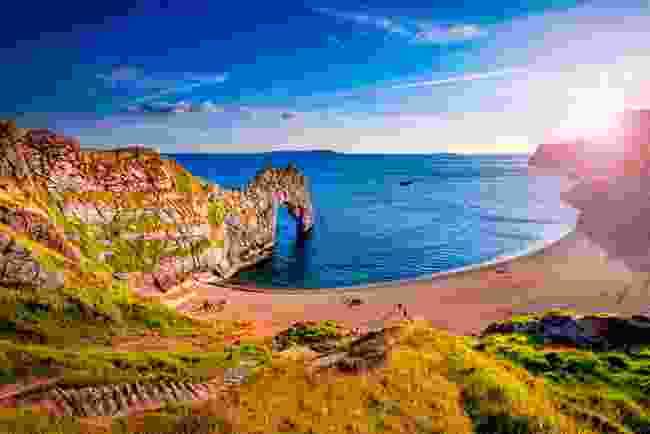 Durdle Door illuminated by the sun in Dorset, England (Shutterstock)