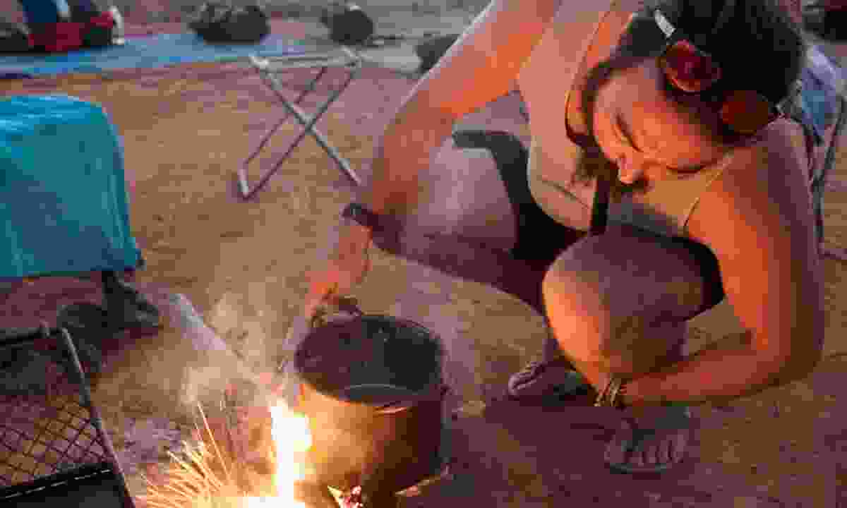 Duffman lights the campfire used both for keeping us warm and for cooking (Phoebe Smith)
