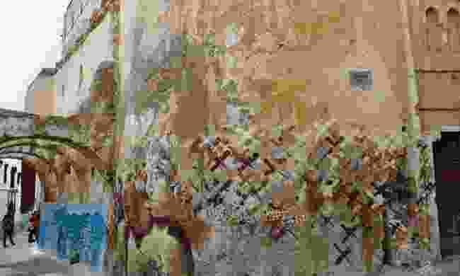 Azemmour wears its art on its scuffed walls (Sarah Gilbert)