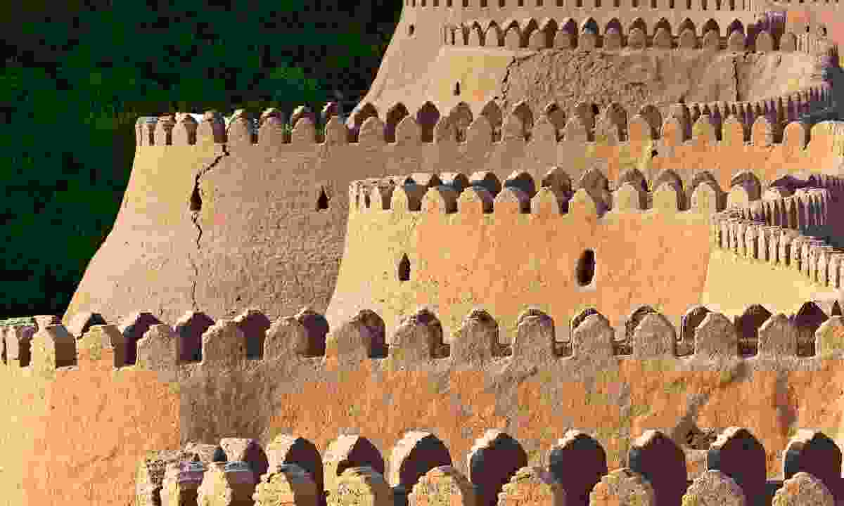 The medieval walls like rows of teeth stand high in front of Khiva (Shutterstock)
