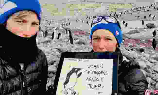 Sophie and Julie Monière staging a women's march in Antarctica (Sophie Darlington)