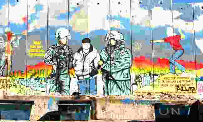 Graffiti on the barrier wall near Bethlehem (Dreamstime)