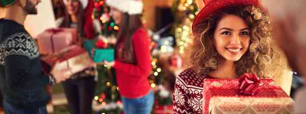 Giving Christmas gifts (Dreamstime)