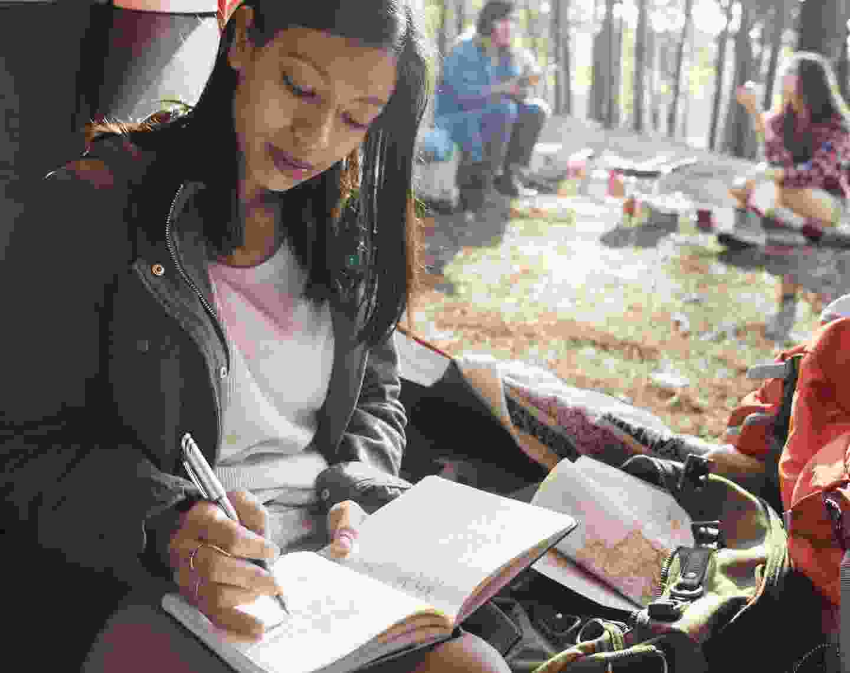 Aspring writer making notes (Dreamstime)