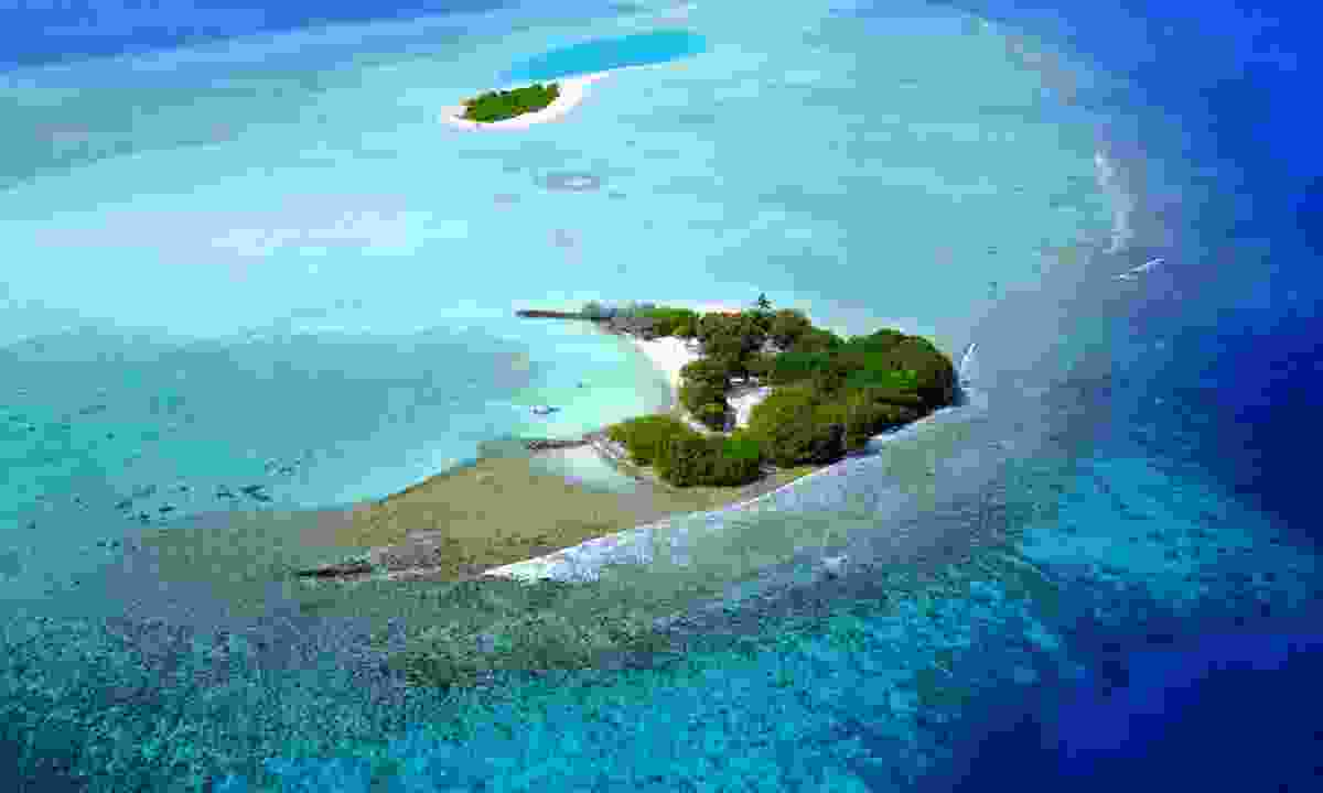 Aerial view of atoll in the Maldives (Shutterstock)