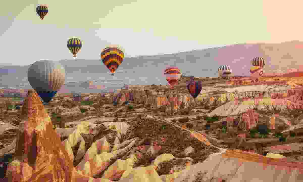 Hot air balloons soar over Cappadocia (Dreamstime)